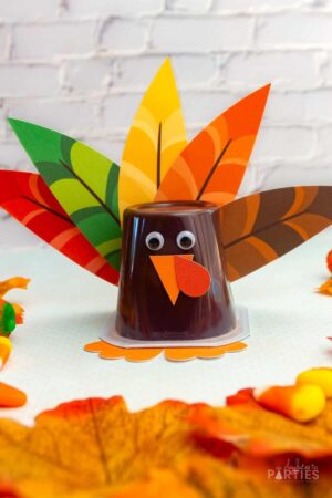 A completed turkey pudding cup in front of a white brick wall.